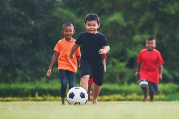 child suffered from cancer playing football