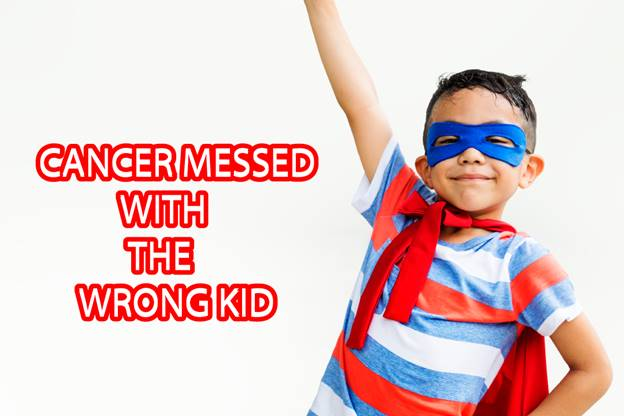 child with cancer wearing super hero outfits